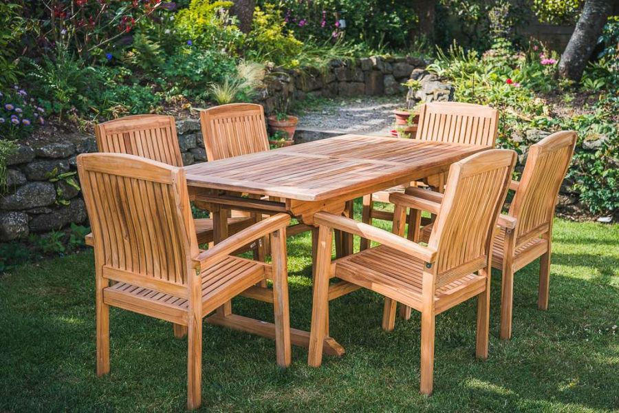 Solid Teak 1.6m Rectangular Chunky Pedestal Table with 6 Charlotte stacking chairs